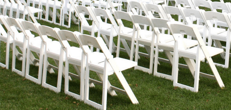 White resin folding chair with seat cushion